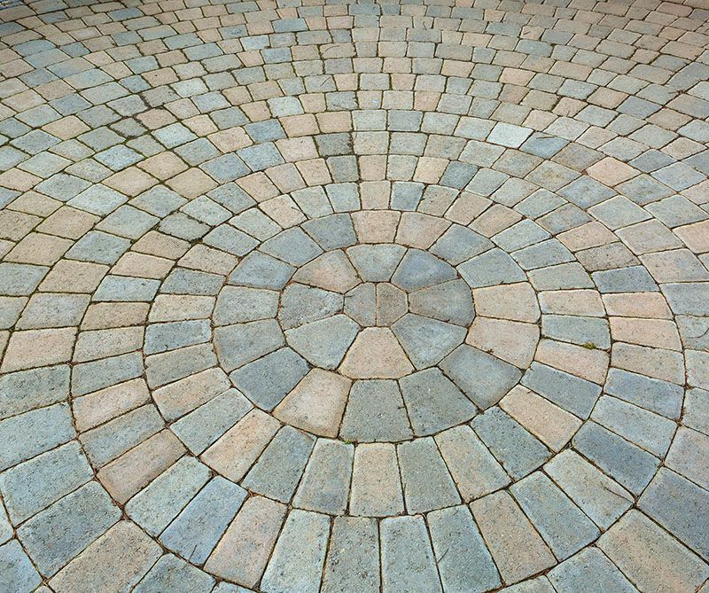 brick patio pavers in circular pattern.